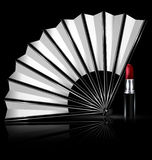 White fan and lipstick Royalty Free Stock Image