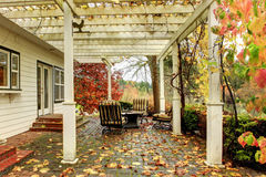 White farm American house during fall with green grass. Covered stock photos