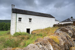 White farmhouse in rural Scot Stock Images