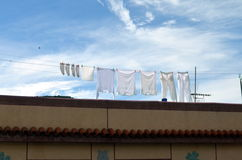 White fashion on clothes line against blue sky Stock Photo