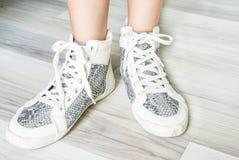 White fashion female boot shoes. Legs Stock Photo