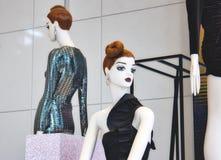 White fashion mannequins displaying elegant clothes stock photos