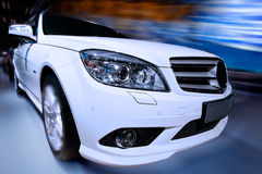White fast car. Brand new white car driving fast Stock Image
