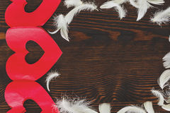 White feathers and red hearts Stock Photo
