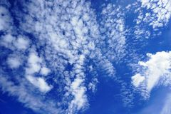 White feathery clouds in blue sky. Beautiful summer cloudscape Stock Photos