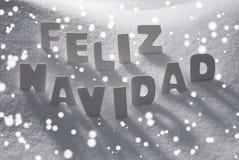 White Feliz Navidad Means Merry Christmas On Snow, Snowflakes Royalty Free Stock Image