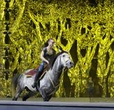 White female acrobat perform equestrian Stock Image