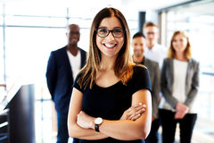 White female executive standing with arms crossed Stock Photos