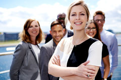 White female executive standing in front of colleagues Royalty Free Stock Photography
