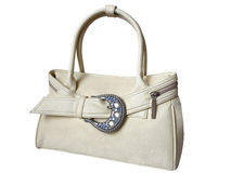 White female handbag isolated on white. White female bag decorated with silver buckle isolated on white Royalty Free Stock Photography