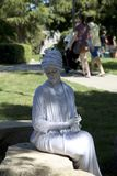 White human sculpture wearing turbans in the park. White female human sculpture wearing turbans in the park, it is Frisco Arts walk  in Hall Park , TX USA 2017 Stock Photos
