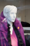 White female mannequin in purple Royalty Free Stock Images