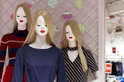 White female mannequins with hair in casual clothes royalty free stock images