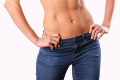 White female torso. Image of a white female wearing jeans Stock Photos