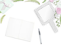 White feminine background. Flat lay. Notebook, pen, pink roses, mirror, leaves, gift. Place for text. Cheerful mind every day Stock Images