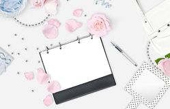 White feminine background. Flat lay. Pink roses, mirror, gift, bag. Place for text. Cheerful mind every day. Mother`s day Stock Image