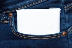 White feminine hygiene pad in a jeans pocket. Close up. Macro Stock Photo