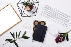 White feminine tabletop flatlay. Home office decor objects. Frame mock-up Royalty Free Stock Photography
