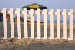 The white fence. On the beach stock photo