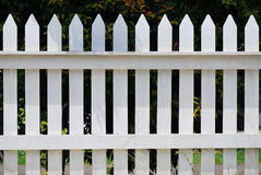 White Fence. A front facing photo taken on a white painted fence Royalty Free Stock Image