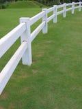 White fence. On green grass in farm Stock Photos