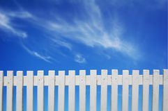 White Fence. A white fence and blue sky Stock Image