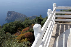 White fence. On the edge above a sea stock images