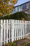 White Fence along Sidewalk Stock Photo