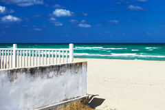 White fence on the beach Royalty Free Stock Image