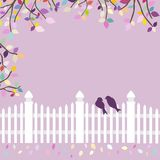 White fence with birds and branches Stock Photo