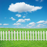 White fence with and blue sky Royalty Free Stock Photo