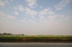 White fence and blue sky. Farmland at Kasetsart University Nakornpathom Thailand with the large blue sky and white fence stock photos