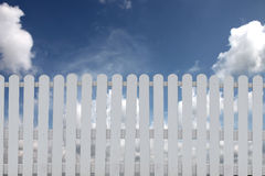 White fence on a blue sky. Stock Images