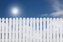White fence on a blue sky. Stock Photos