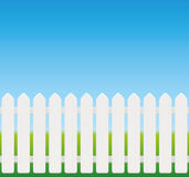 White Fence Comic Style. White picket fence, comic style, wooden texture - seamless expandable - isolated vector illustration on green to sky blue gradient Royalty Free Stock Photos