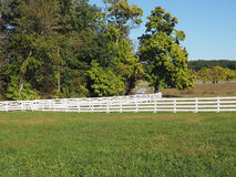 White fence by a country lane Stock Photo