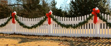 White Fence Decorated for Christmas Royalty Free Stock Photos
