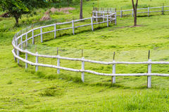 White fence in farm Stock Photo