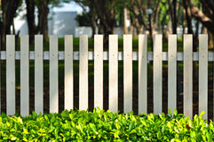 white fence in front of garden Stock Images