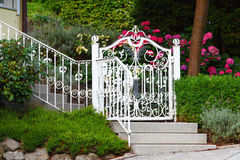 White fence gate. The white fence gate with flowers Royalty Free Stock Photography