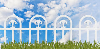 White fence and grass Stock Photography