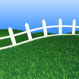 White fence on green grass Stock Photography