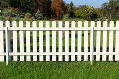 White fence on green grass. Royalty Free Stock Photos