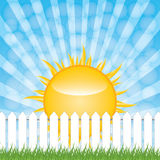 White fence and green grass on blue sky background Royalty Free Stock Image