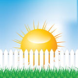 White fence and green grass on blue sky background Stock Photo