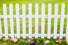 White fence with green grass Royalty Free Stock Photos