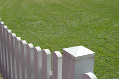 White fence and green grass of home Stock Images