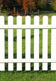White fence on green grass. Royalty Free Stock Image