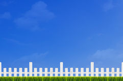 White Fence and Green Grass Royalty Free Stock Photo