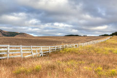 White Fence on the High Plains Royalty Free Stock Photos